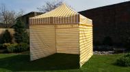 Stabilní nůžkový stan 3x3 m PROFI STEEL žluto-bílý s boky najde uplatnění na zahradách rodinných domů i na festivalech a jiných venkovních akcích.
